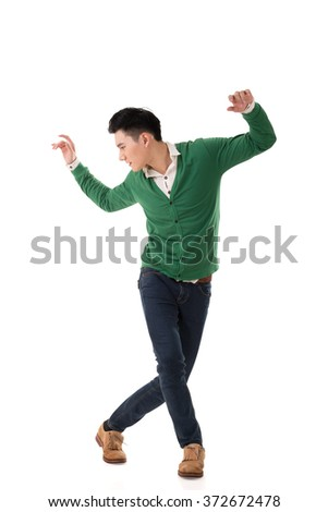 Asian young man dance, full length portrait isolated.