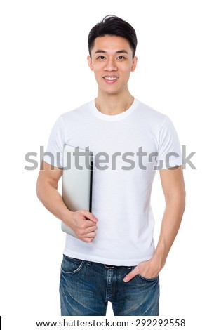 Asian young man hold with laptop computer - stock photo