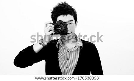 Asian young man photographer isolated with white background - stock photo