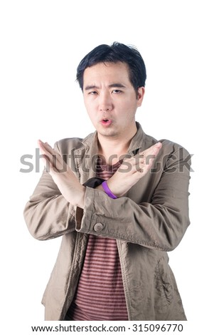 Asian Young man pumped up, making X sign shape with his arms and hands, cross his arms and hands, say no, isolated on white background.