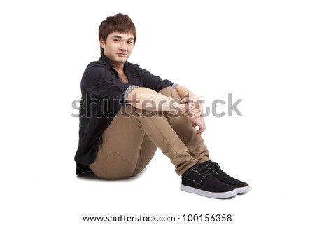 Asian young man sitting and isolated on white