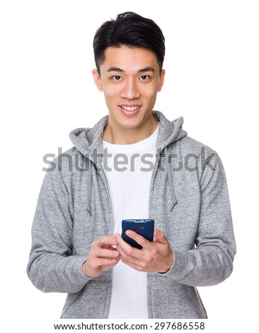 Asian young man use of the cellphone - stock photo