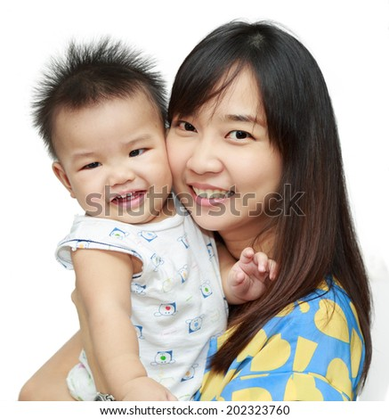 Asian young mother smile and happy with her sun - stock photo