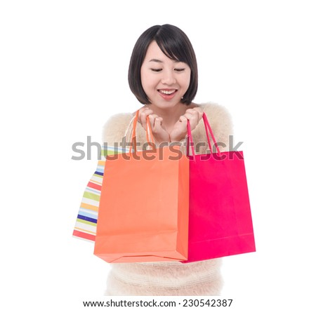 Asian young smile woman holding shopping bags