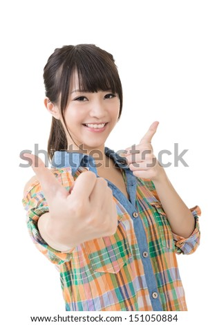 Asian young smiling woman thumbs up. Close up portrait. Isolated on the white background. - stock photo