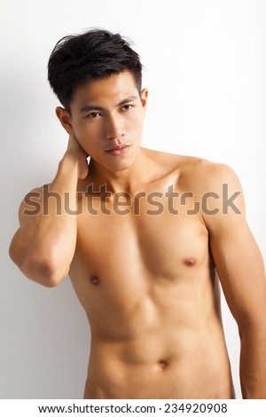 asian young sport man with perfect fitness body - stock photo
