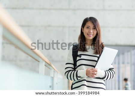 Asian young student in university school - stock photo