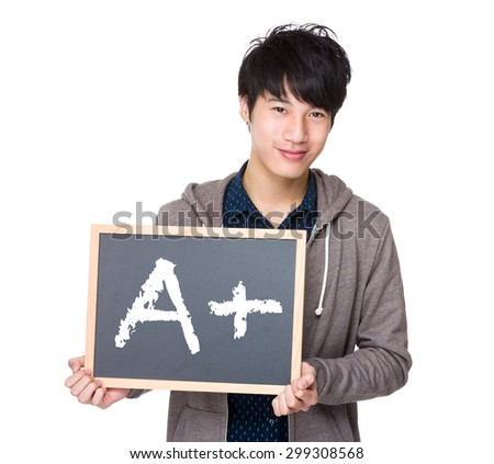 Asian young student with blackboard showing sign of A plus - stock photo