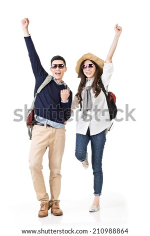 Asian young traveling couple feel exciting and dancing, full length portrait isolated on white background. - stock photo