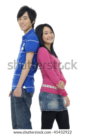 Asian young woman and man standing back to back