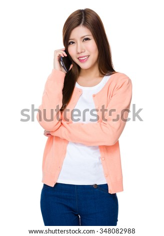 Asian Young Woman chat on cellphone - stock photo