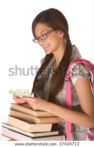 Asian young woman college student with backpack in eyeglasses and pile of books counting money - stock photo