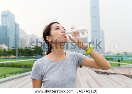 Asian Young Woman drink of the water bottle - stock photo