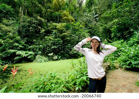asian young woman enjoying green nature environment in the park