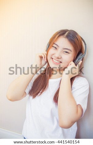 asian young woman enjoying with her music listening - stock photo