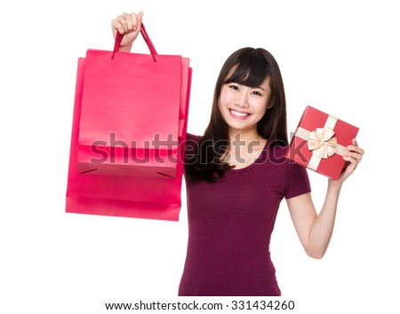 Asian Young woman hold with shopping bag and present box