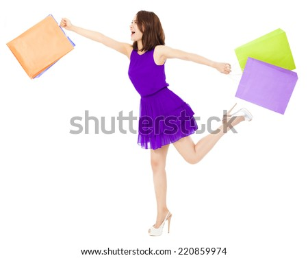 asian young woman holding shopping bags and running.  isolated on white background