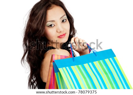 Asian young woman in skirt with shopping bags, isolated on white