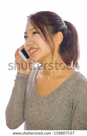 Asian young woman on a phone cellphone iPhone talking calling long distance