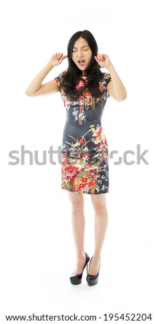 Asian young woman shouting with hands in ear - stock photo