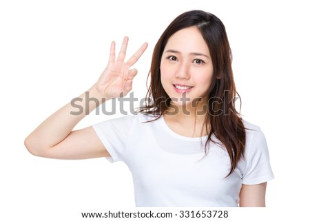 Asian young woman showing ok sign gesture - stock photo