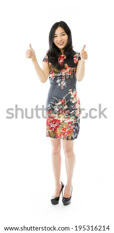 Asian young woman showing thumbs up from both hands isolated on white background - stock photo
