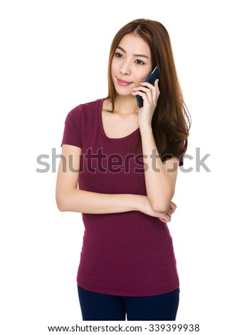 Asian Young Woman talk to the cellphone