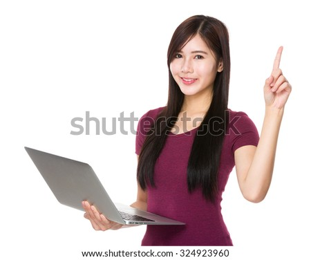 Asian young woman use of laptop computer and finger point up