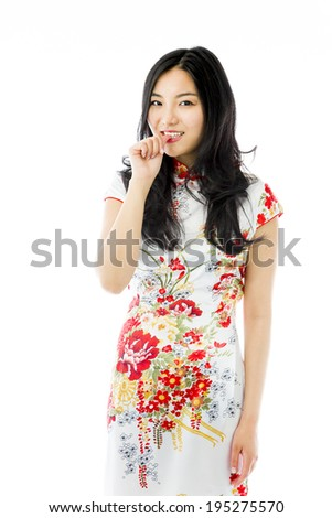 Asian young woman with finger in mouth - stock photo