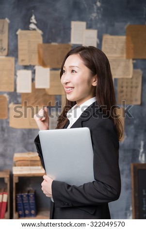 asian young woman with laptop