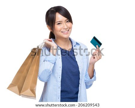 Asian young woman with shopping bag and credit card isolated on white background