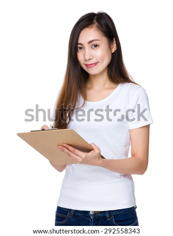 Asian young woman write on file board