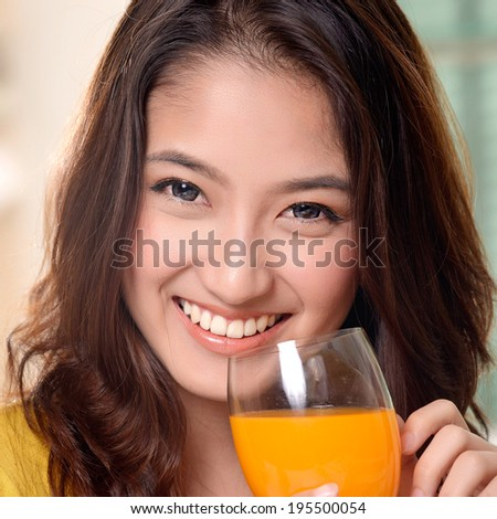 Asian young women cute woman drinking orange juice - stock photo