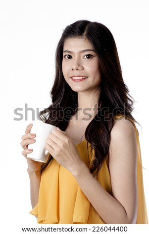 asian young women drinking coffee on white background - stock photo