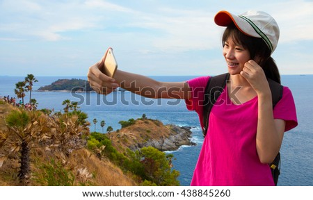 Asian young women selfie happy vacation at Promthep Cape in Phuket Thailand - stock photo