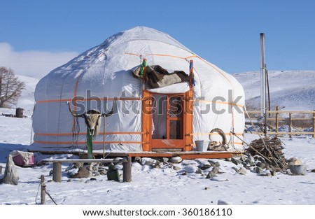 Asian yurt in the winter landscape in the mountains - stock photo