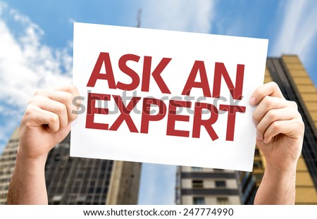 Ask an Expert card with a urban background - stock photo