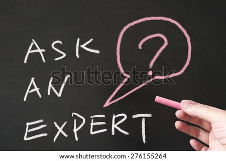Ask an expert words written on blackboard using chalk - stock photo