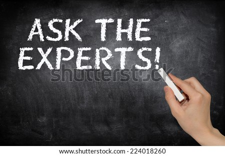 Ask the experts!, written with white chalk on a blackboard - stock photo