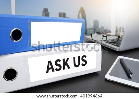 ASK US concept Office folder on Desktop on table with Office Supplies. - stock photo