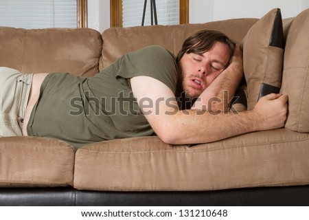 Asleep on the couch after a hard day. - stock photo