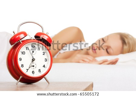 Asleep woman and alarm clock.