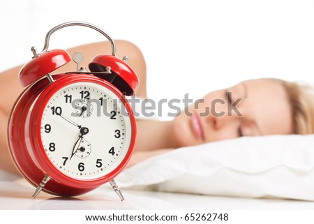 Asleep woman with alarm clock.