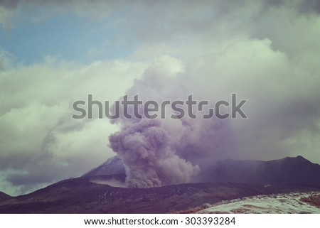 Aso volcano mountain in Vintage style. Clouds and mist floating on mountain snow.
