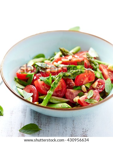 Asparagus and Cherry Tomato Salad with Pine Nuts and fresh Herbs - stock photo