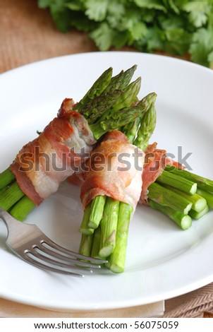 Asparagus and pancetta wraps - stock photo
