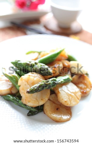 Asparagus and scallop stir fried - stock photo