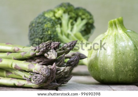 asparagus, broccoli and round zucchini  selection on wooden table - stock photo
