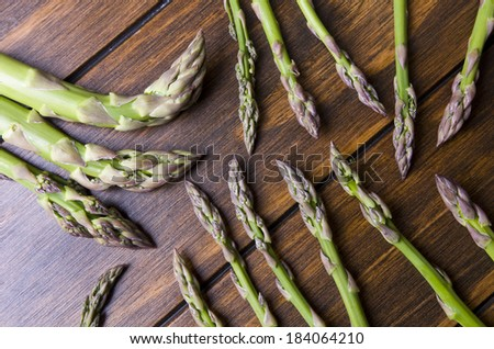 Asparagus Bunch on wood table with differents size