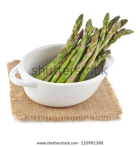 Asparagus in ceramic pot  isolated on a white background - stock photo